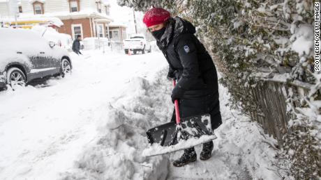 BOSTON, MA - DECEMBER 17:  A woman shovels a sidewalk on December 17, 2020 in Boston, Massachusetts. More than a foot of snow is expected in the Greater Boston area as Winter Storm Gail delivers snow, rain, sleet and high winds up and down the East Coast.  (Photo by Scott Eisen/Getty Images)
