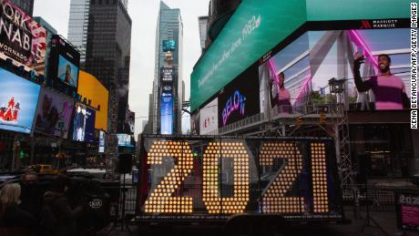 "A lit sign showing ""2021"" arrives in New York's Times Square on December 21."