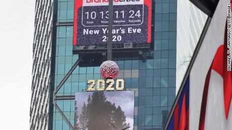 A countdown clock is seen behind the 2020 New Year's Eve numerals on December 21, 2020 in New York.