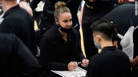Becky Hammon calls a play during a timeout in the second half during the Spurs' game against the Lakers.