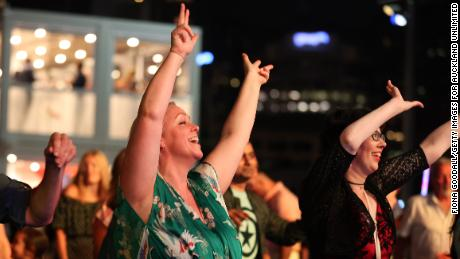 People enjoy music at Americas Cup Village during New Years Eve celebrations in Auckland, New Zealand, on December 31, 2020.