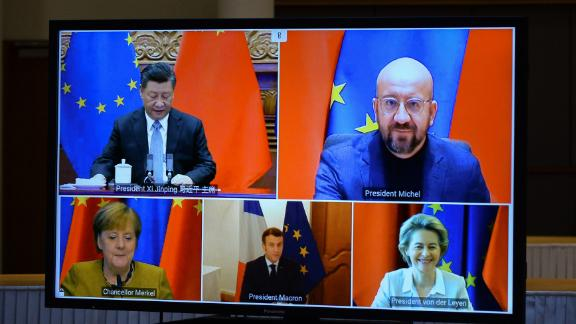 Chinese President Xi Jinping and European Union leaders seen on a screen during a video conference to approve an investment pact between China and the European Union on December 30, 2020 in Brussels, Belgium.