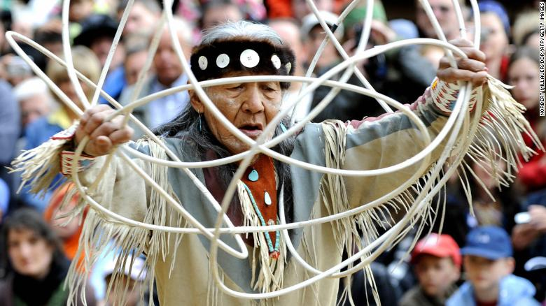 Navajo elder Jones Benally performs a traditional hoop dance at a festival in Germany in 2008.