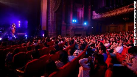 By late 2021, Americans hope to see some normalcy return to their lives. Here, people attend a performance at the Civic Theatre on November 27, 2020 in Auckland, New Zealand.
