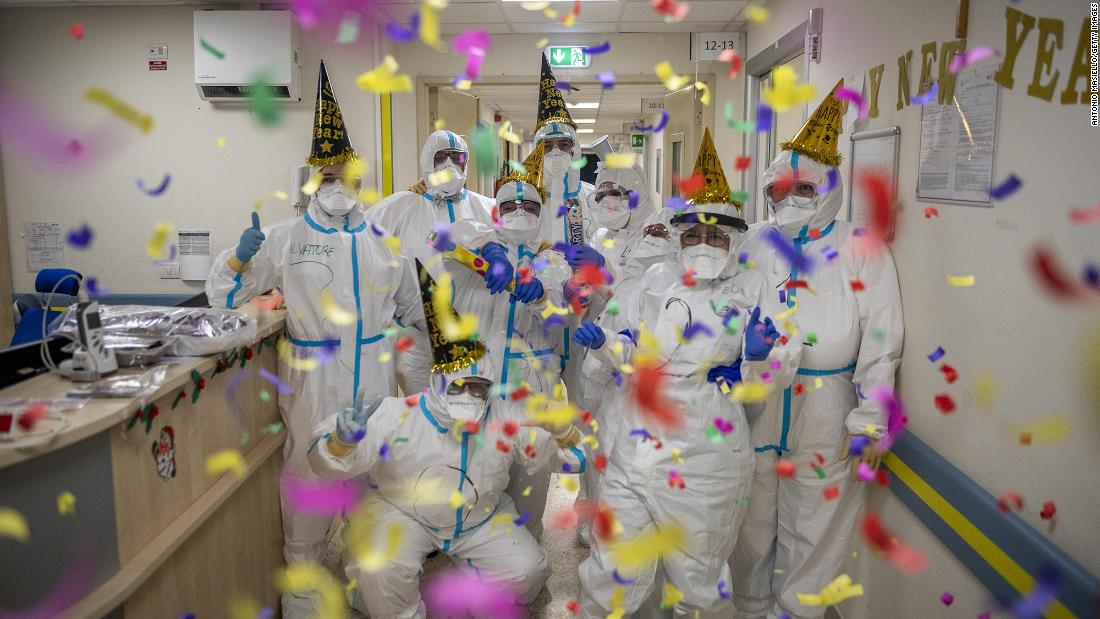 "Health-care workers <a href=""https://www.cnn.com/2020/12/31/world/gallery/2021-new-year-celebrations/index.html"" target=""_blank"">celebrate the new year</a> in the intensive care unit at the San Filippo Neri Hospital in Rome."