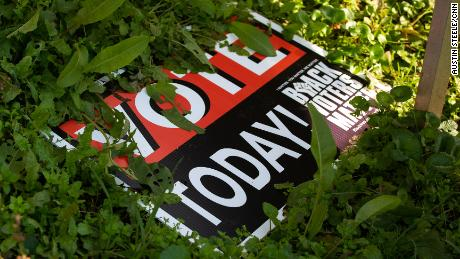 A voting sign lays in the grass last month outside a home on the outskirts of Sparta.