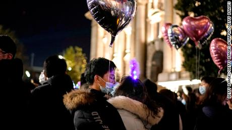 A couple kiss as New Year approaches on December 31, 2020 in Wuhan.