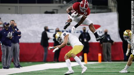 Alabama running back Najee Harris hurdles a Notre Dame defender during the Rose Bowl College Football Playoff Semifinal game on Friday, January 1.