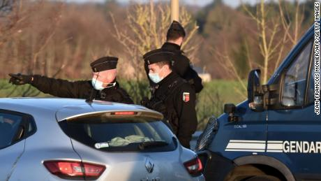 French gendarmes block access to the party about 40km south of Rennes on New Year's Day.