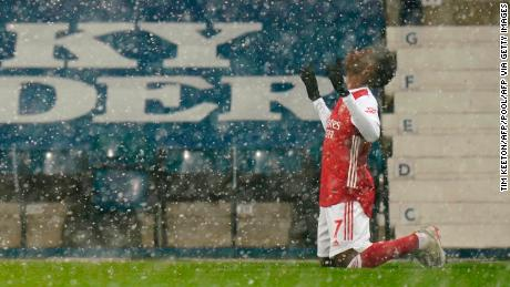 A wintery scene at The Hawthorns as Bukayo Saka celebrates Arsenal's superb second goal in the 4-0 win over West Bromwich Albion.