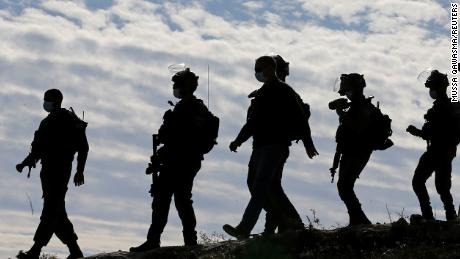 Members of the Israel Defense Forces (IDF) arrive at the site where a Palestinian house was demolished near Hebron in the West Bank on November 25, 2020.