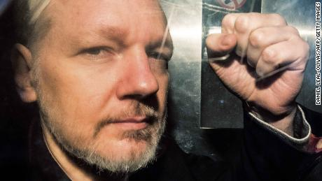 Assange gestures from the window of a prison van on May 1, 2019.