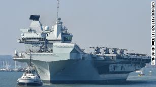 UK says its aircraft carrier strike group is ready to deploy. China's already watching