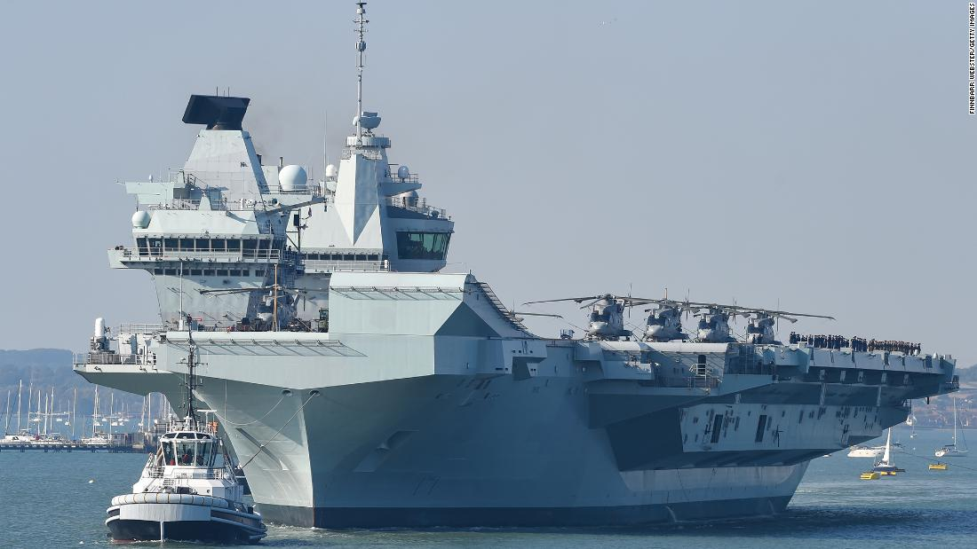 UK says aircraft carrier strike group is ready to deploy. China's already watching