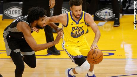 Curry is guarded by Marvin Bagley III of the Sacramento Kings at Chase Center.
