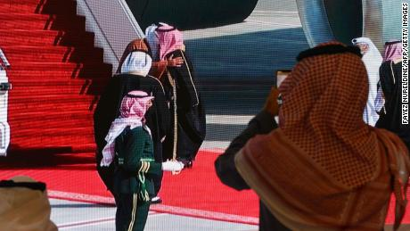 Saudi Crown Prince Mohammed bin Salman embraces Qatar's Emir ahead of the summit in Saudi Arabia on Tuesday.
