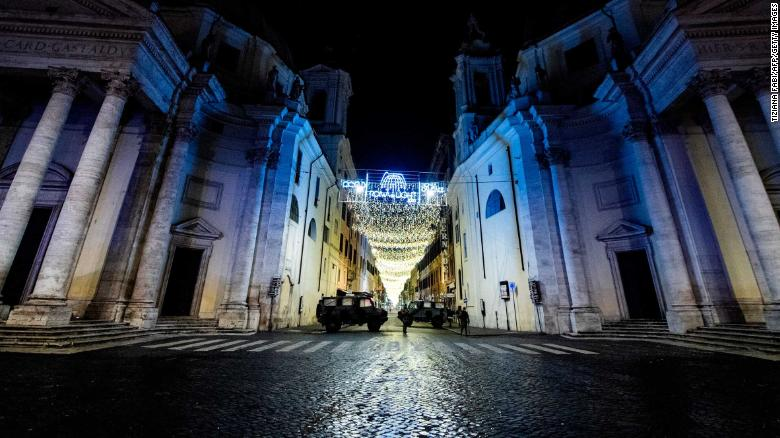Military vehicles patrol on Piazza del Popolo in central Rome on December 31, 2020.