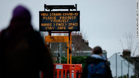 A billboard warns commuters of the new Covid variant at a station in Walthamstow, London on January 5.