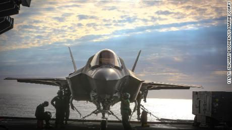 US Marines complete pre-flight checks in an F-35B jet aboard HMS Queen Elizabeth at sea on September 28, 2020.