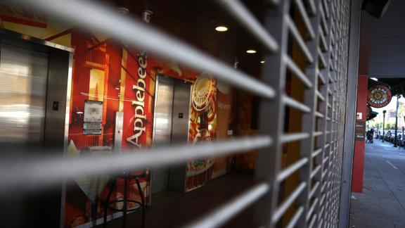 A security gate blocks the entrance to a closed Applebee's restaurant on August 13, 2020 in San Francisco, California.
