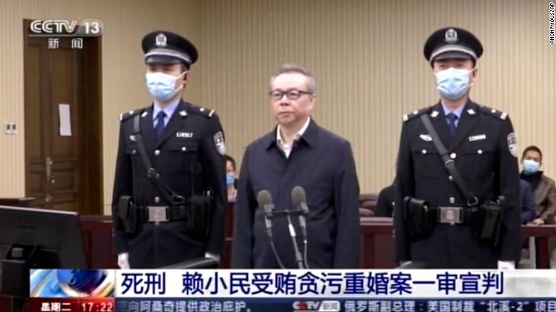 China sentences former top finance executive to death for bribery