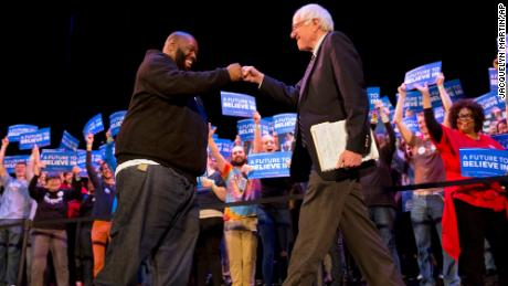 Rapper Killer Mike and Democratic presidential candidate Sen. Bernie Sanders, I-Vt., fist bump at the start of a campaign rally in Columbia, S.C., Friday, Feb. 26, 2016, the day before the South Carolina Democratic Primary.