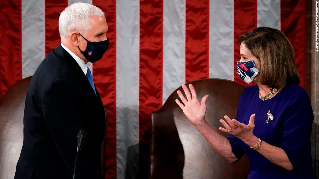 Vice President Mike Pence and House Speaker Nancy Pelosi officiate the joint session of Congress on Wednesday. Congress was meeting to count and certify the Electoral College votes before the Capitol was breached.