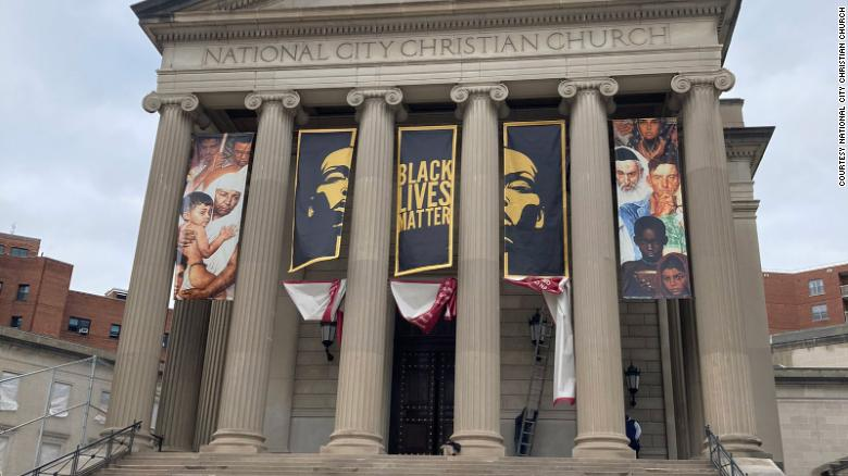 A church installs a Black Lives Matter banner ahead of pro-Trump protests in Washington, DC