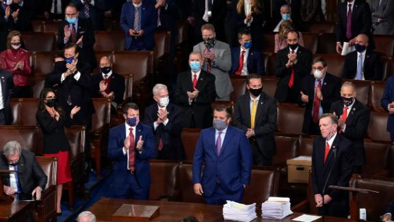 Republicans applaud after US Rep. Paul Gosar, lower right, objected to certifying the Electoral College votes from Arizona.
