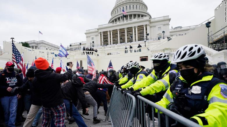 Police clearing pro-Trump mob from US Capitol after rioters stormed halls of Congress