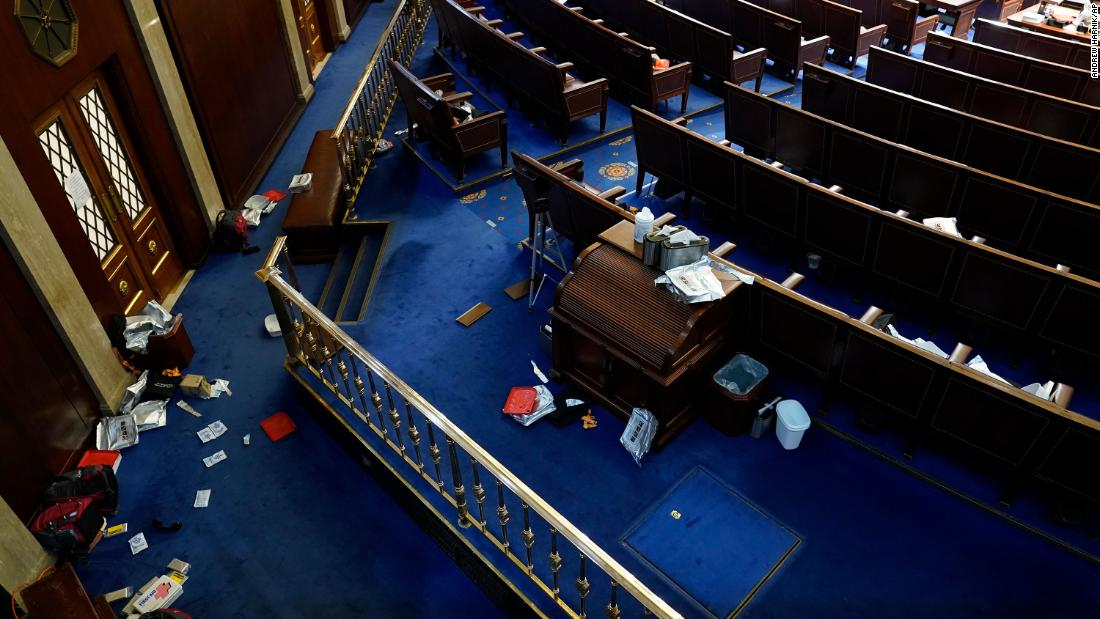 Papers and other materials litter the House chamber after it was evacuated.