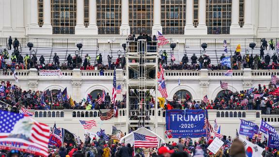 Trump supporters gather outside the Capitol, Wednesday, Jan. 6, 2021, in Washington. As Congress prepares to affirm President-elect Joe Biden