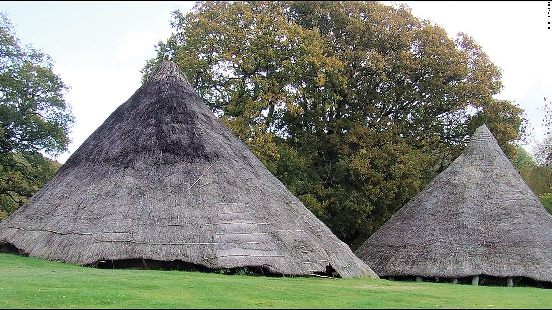This image shows the Cook House (right) and the Earthwatch roundhouse reconstructions (left) prior to their dismantling and excavation at the Castell Henllys Iron Age site in Wales.