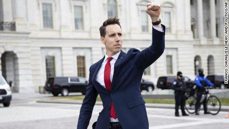 Sen. Josh Hawley gestures toward a crowd of supporters of President Donald Trump gathered outside the US Capitol to protest the certification of President-elect Joe Biden's electoral college victory Jan. 6, 2021. Some demonstrators later breached security and stormed the Capitol.