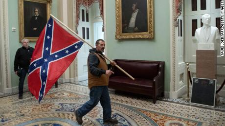 A Confederate flag at the Capitol summons America's demons
