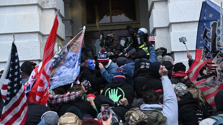 Trump supporters clash with police as they storm the US Capitol on January 6, 2021.
