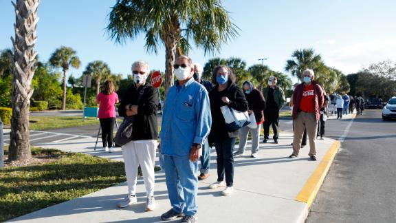 Seniors wait in line outside a library in Fort Myers last week, hoping to get one of 800 doses of coronavirus vaccine available at the site.