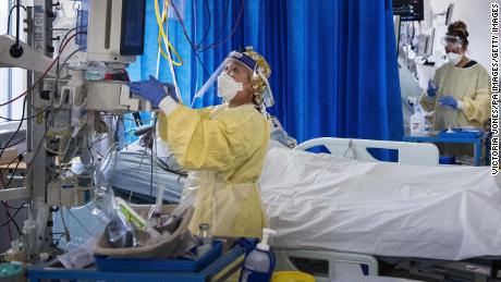 Nurses work on patients in the intensive care unit of a hospital