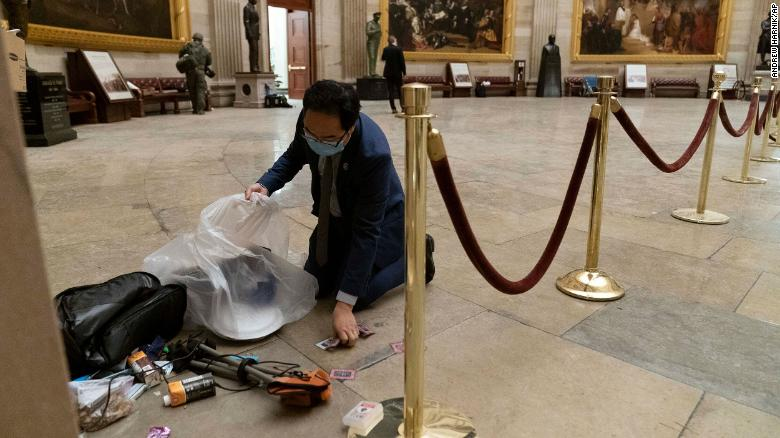A Congressman got on his knees to pick up trash left after the deadly Capitol riot