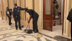 The same House chamber doors where the armed standoff took place hours ago is being cleaned for members to return for the joint session.