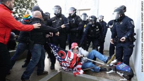 Law enforcement confronted protesters outside the Oregon State Capitol Dec 21.