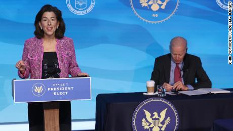Rhode Island Gov. Gina Raymondo (L) made the remarks after US President-elect Joe Biden (R) announced her as his trade secretary nominee at The Queen Theater on January 8, 2021 in Wilmington, Delaware.