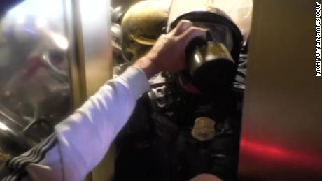 Disturbing video shows officer crushed against door by mob storming the Capitol