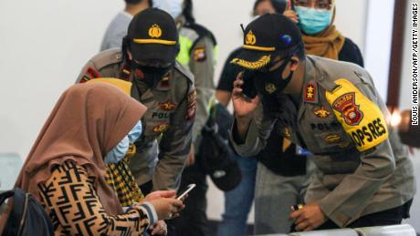 Relatives of passengers on board missing Sriwijaya Air flight 182 wait for news at the Supadio International Airport in Pontianak on Saturday.