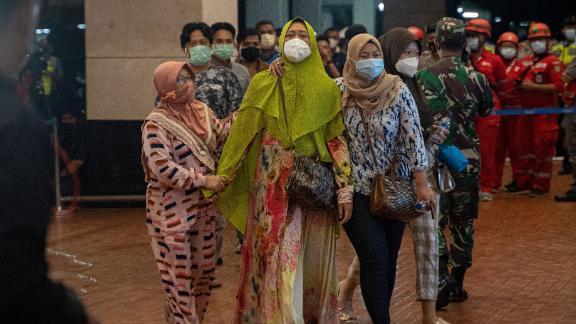 Passengers' relatives arrive at the Soekarno-Hatta International Airport near Jakarta.