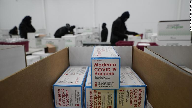 Boxes containing the Moderna vaccine are prepared to be shipped at the McKesson distribution center in Olive Branch, Mississippi on December 20.