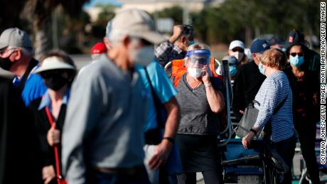 Seniors and first responders wait in line to receive a vaccine in Fort Myers, Florida on December 30.
