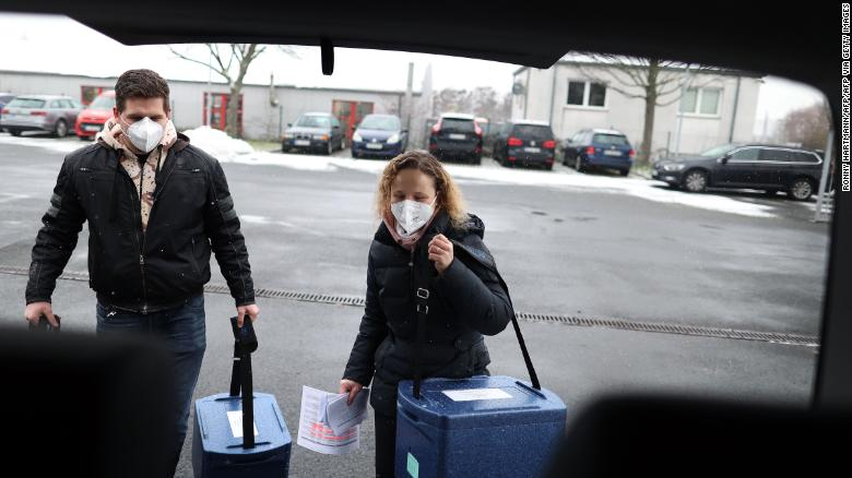 Employees carry boxes with the Pfizer/BioNTech vaccine to a  Covid-19 center near Magdeburg, Germany on January 8.