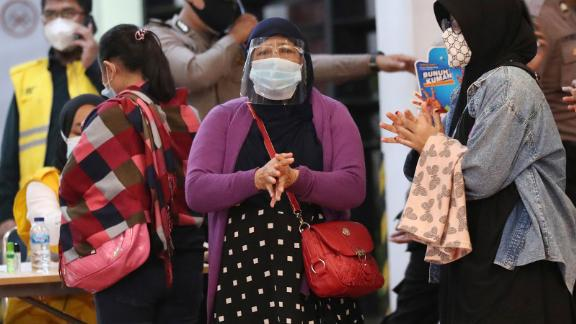 Relatives of passengers arrive at an airport crisis center on Saturday, January 9.