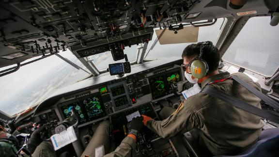 Indonesian Air Force pilots work in the cockpit during an aerial search on January 10.